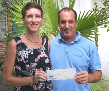 Pictured (L to R): Sandy Golding, President of Beaches Watch Inc.; Mitch Kaufmann, Vice President of WaveMasters Surf Club.
